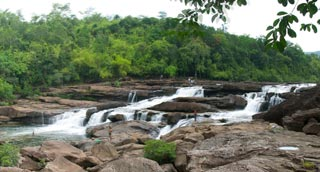 Float through the Cardamom rain-forest to the relaxing Tatai Falls