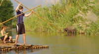 Take a leisurely ride down the scenic Pai River in a unique bamboo raft