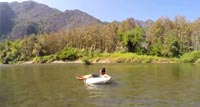 Make your own way down the fascinating Pai River sitting in a huge rubber ring