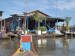 Fully functioning village life on the Tonle Sap River