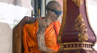 A 40-year-old mummified monk wearing sunglasses must be unique!
