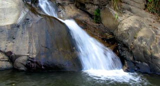 Cool down and have a refreshing bathe in one of three waterfalls near town